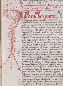 AA7 folio 24 recto : En-tête d'une lettre de la comtesse de Provence Yolande d'Aragon (1400-1417, dcd en 1442) datant de 1419 et recopiée dans le cartulaire, ornée d'une grande lettrine à l'encre rouge avec grotesque. En bas, le long du texte apparaît un masque de théâtre
