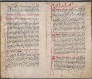 AA7 folios 20 verso et 21 recto : Lettres du comte de Provence Louis II (1384-1417) datant de la période 1402-1410 qui montrent la profusion du décor, notamment à droite dans la marge du bas les nombreux grotesques accrochés aux hampes des lettres